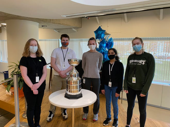 From left, AMSA students Evangelina Burdick, Gabriel Ingelido, Allison Silva, Jewel Pauly and Sydney Kerivan have been working in the labs at Quest Diagnostics as part of an internship program the past few weeks.