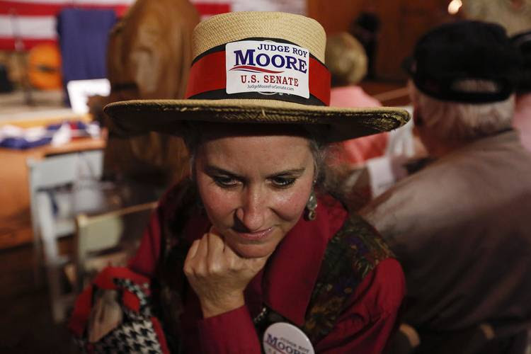 Moore supporter Sherri Martin waits for him to speak last night. (Brynn Anderson/AP)