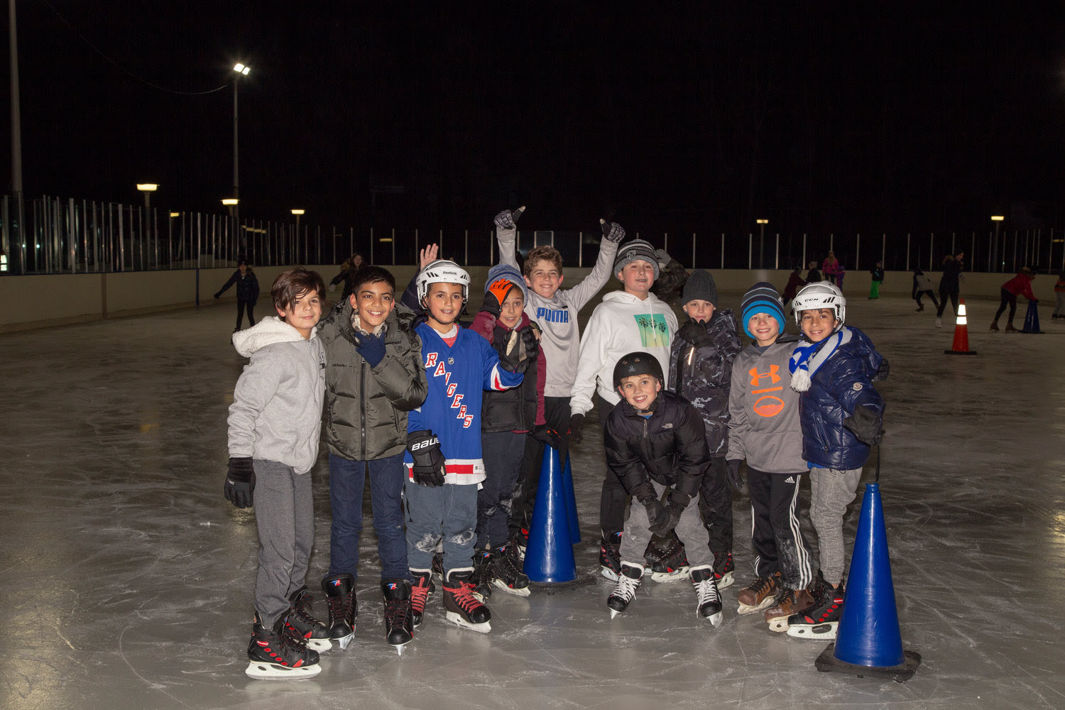 On the Grant Park ice rink at the Chabad of Hewlett's Hanukkah on Ice from left Johnathan, Tomir, Nathan, Roy, Justin, Orr, Shaan, Stefano, Ari and Merrick.