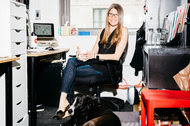 Julie Samuels, the executive director of Tech:NYC, with her dog, Daley, in her office at WeWork NYC. The organization will work with officials on issues that affect tech companies, before laws are passed.
