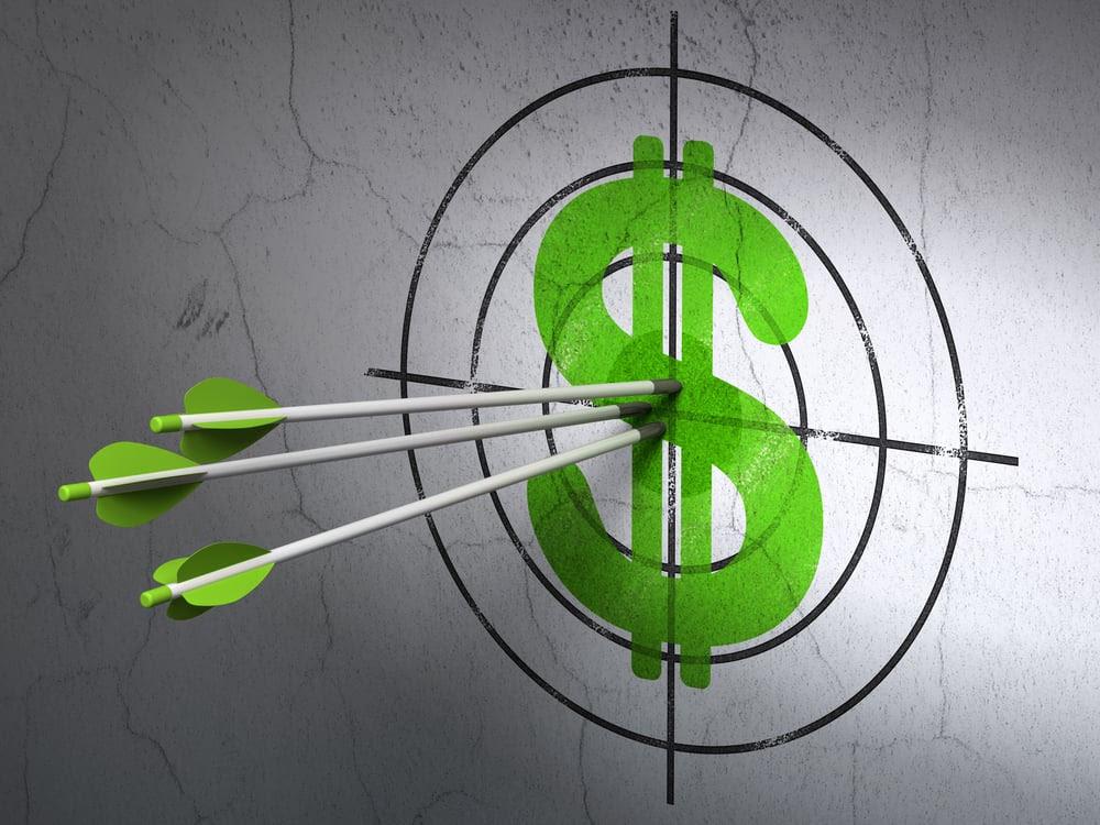 Three arrows hitting a dollar sign target