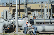Workers at a pipeline hub run by Spectra Energy Corporation in Guilford, Pa.