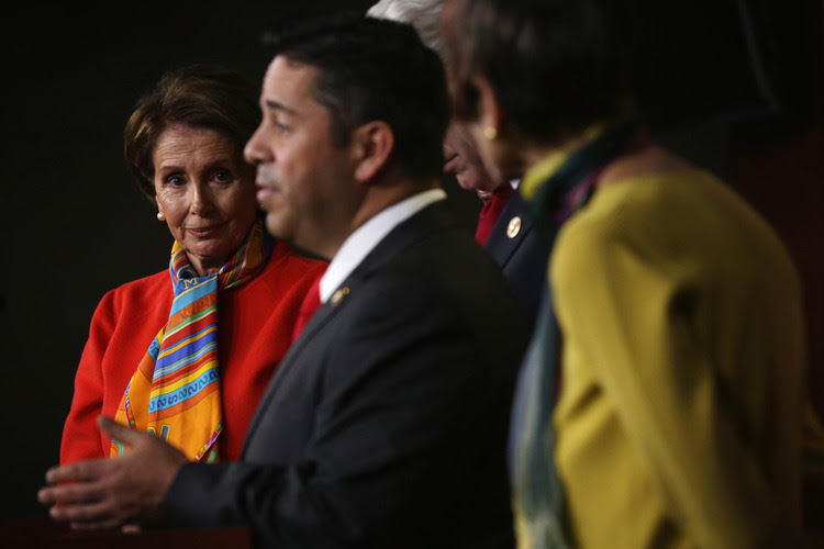 Ben Ray Luj&aacute;n and Nancy Pelosi during a recent news conference at the Capitol. (Alex Wong/Getty)</p>