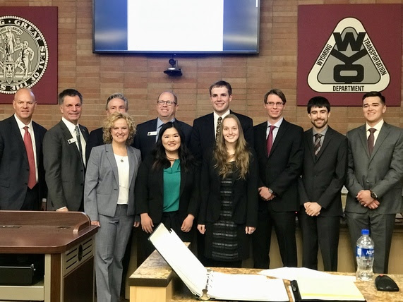 State Superintendent Jillian Balow stands with the Governor, State Treasurer, Secretary of State, and college students in the WYDOT auditorium, where SLIB met and heard an update from the class.