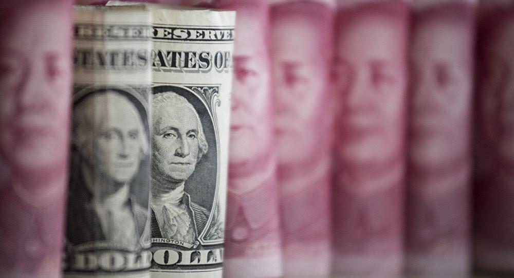 Yuanes y dólares (monedas de China y EEUU, respectivamente)