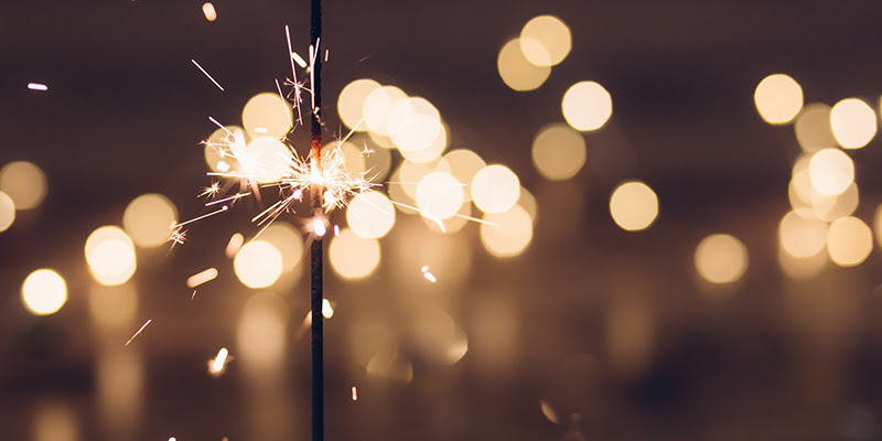 Photo of .sparkler with soft yellow bokeh effect
