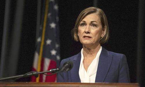 Iowa Governor Signs Bill Into Law Letting Residents Buy, Carry Guns Without Permits