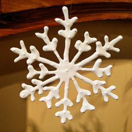 Delicate, white ceramic snowflake