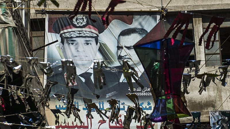 Portraits of Egyptian President Abdel Fattah el-Sisi and late president Gamal Abdel Nasser are seen on a wall in Cairo [Getty]