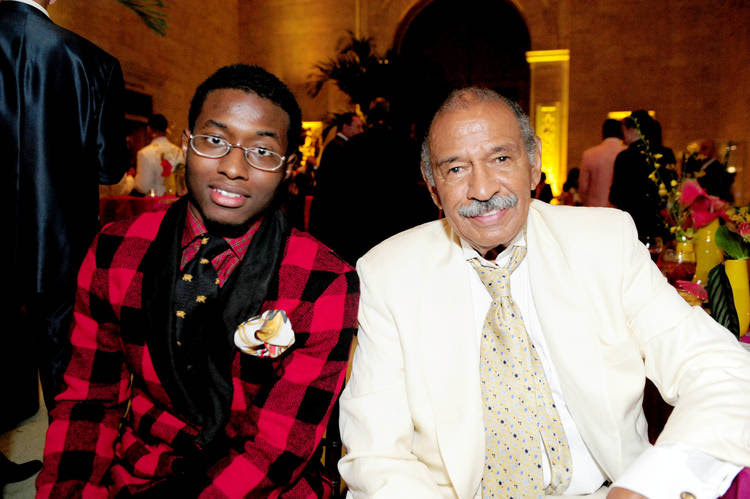 John Conyers III poses in 2011 with his father, ex-Rep. John Conyers, in Detroit. (Ricardo Thomas/Detroit News via AP)