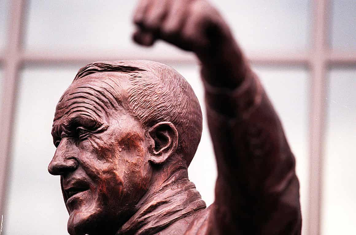 The bronze statue of Bill Shankly stands outside of The Kop at Anfield.