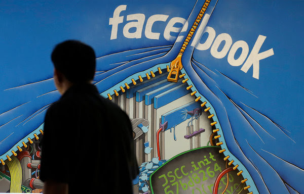 A Facebook mural on the company's campus in 2014. Facebook is under fire for running ads purchased by fake users trying to cause disruption in the American electorate.
