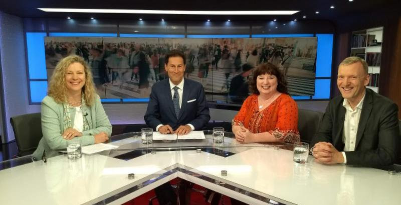 Three panelists with host at TVO The Agenda with Steve Paikin
