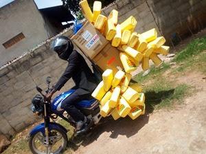 Alex Taking supplies to Muira and Kamira