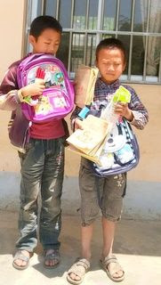 Wei Senbao and his cousin with school supplies