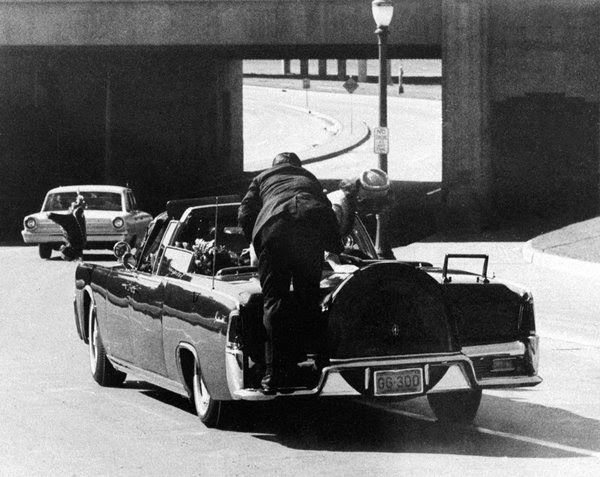 Clint Hill, who was in Jacqueline Kennedy's Secret Service detail, on the back of the limousine moments after the shooting on Nov. 22, 1963.