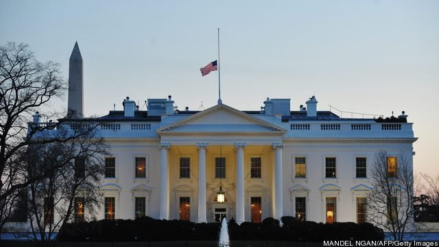 The US flag flies at half-staff above th