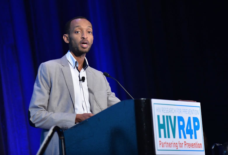 USAID-supported scientist, Julien Nyombayire, presents during a session on vaccines at HIVR4P. Photo credit: HIVR4P