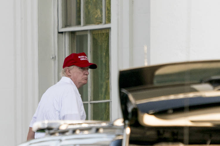 Donald Trump arrives back at the White House yesterday after playing golf at his club in Sterling, Va. (Andrew Harnik/Associated Press)
