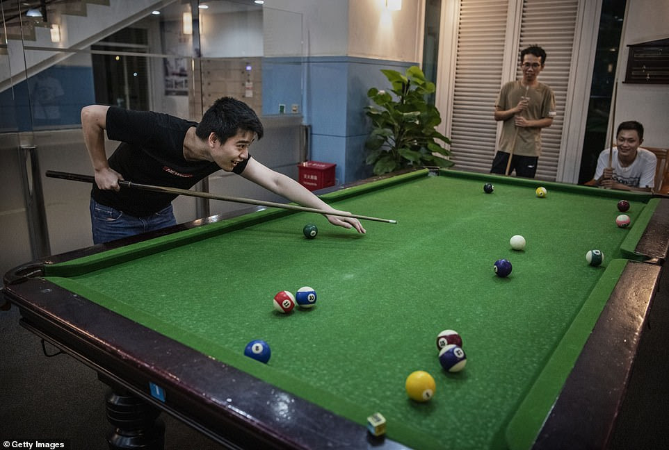 They are also seen enjoying a game of pool after work at the office's recreation centre