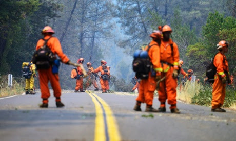 Crews clear brush along a road near the Butts Fire in preparation for a firing operation in the Napa County.