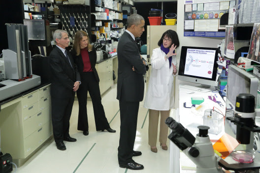 Dr. Nancy Sullivan of NIH's National Institute of Allergy and Infectious Diseases (NIAID) discussing Ebola research with President Barack Obama as NIA