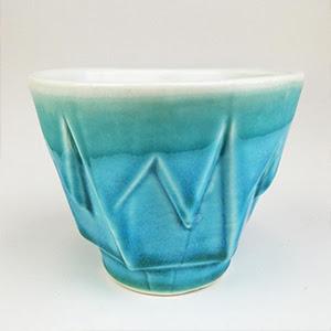 A photograph of a blue ceramics cup.