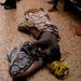 Wounded civilians lay on the floor of a hospital on Thursday in Bangui, the capital of the Central African Republic.