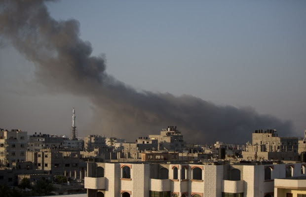 Smoke billows from buildings in Gaza City.