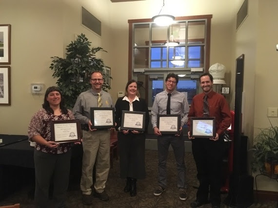 The five finalists stand holding their framed certificates for being state finalists for the Presidential Award for Excellence in Math and Science Teaching.