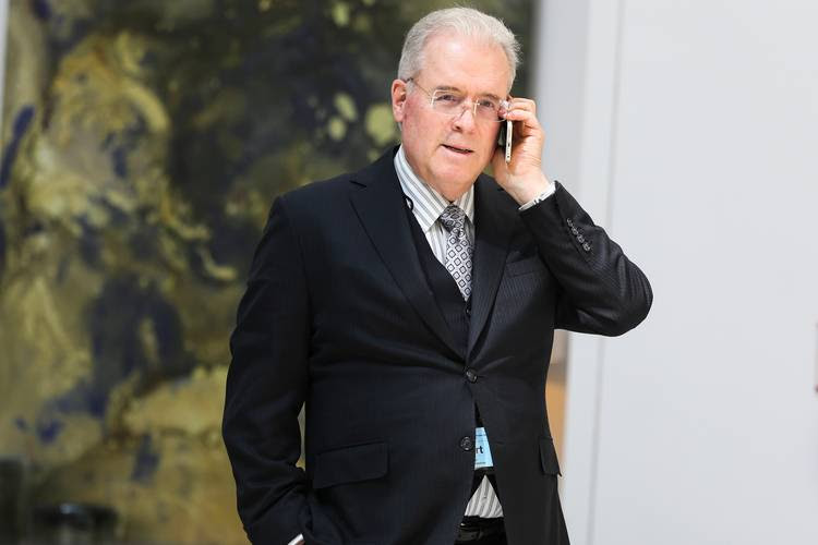 Billionaire Robert Mercer speaks on the phone during the 12th International Conference on Climate Change. (Oliver Contreras/The Washington Post)