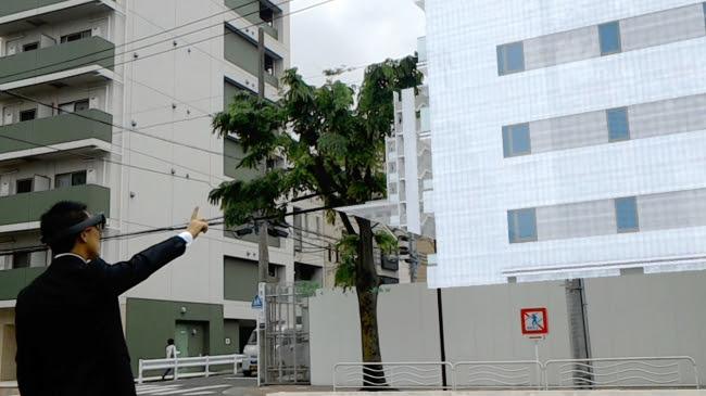 建設地にマンションの完成イメージを表示