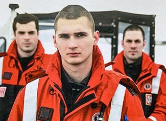 Conservation officer Jeremy Sergey is shown with two fellow U.S. Coast Guardsmen in 2009.