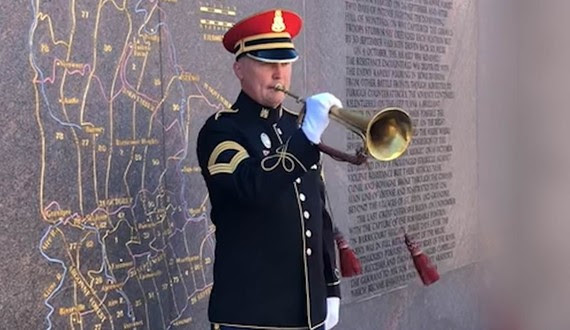 Bugler plays taps at memorial on Generals bugle