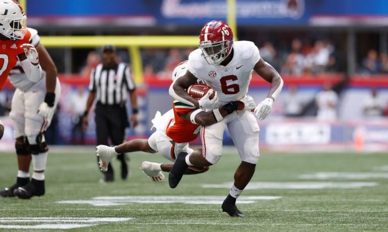 Trey Sanders (#6) breaks a tackle for Alabama versus Miami