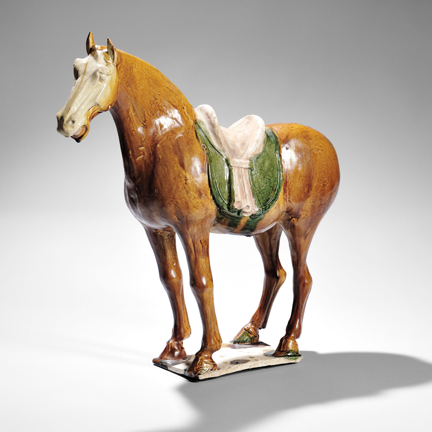 Sancai-glazed Caparisoned Horse, China, Tang dynasty (Lot 57, Estimate $15,000-20,000)