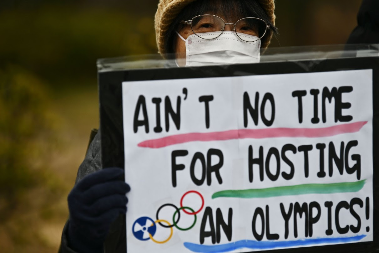 Japanese protestor holding an anti-Olympics sign. (Getty Images)