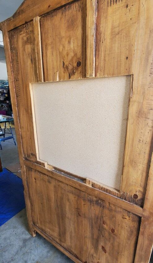 TV cutout on back of hutch covered by plywood
