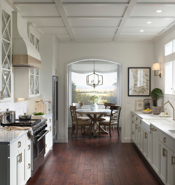 All white and gold trimmed kitchen decor.