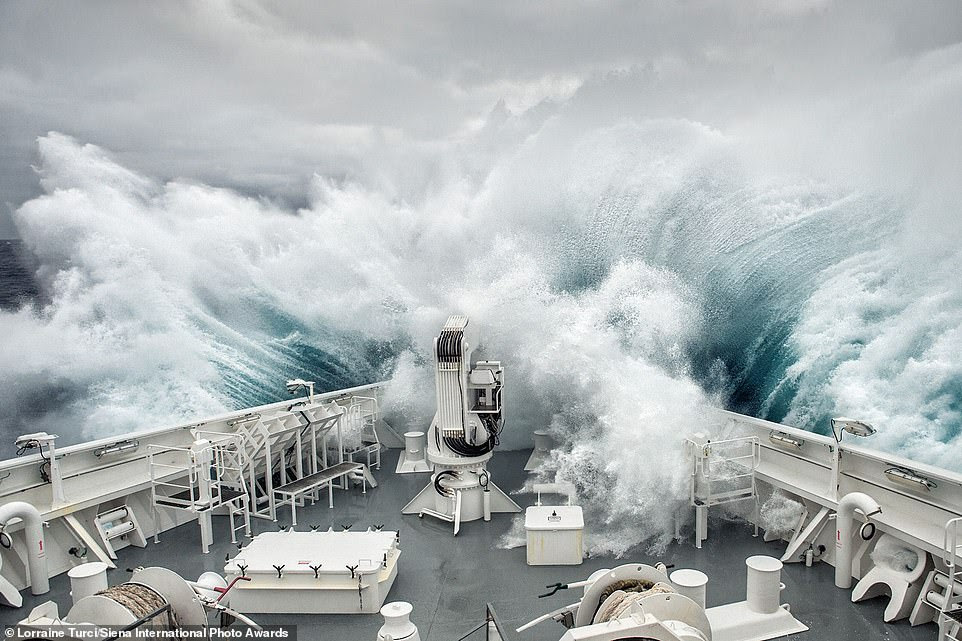 French photographer Lorraine Turci won third place in the 'journeys and adventure' category for this dramatic image of a boat being battered with 40ft waves in the South of Drake Passage between Cape Horn and Antarctica