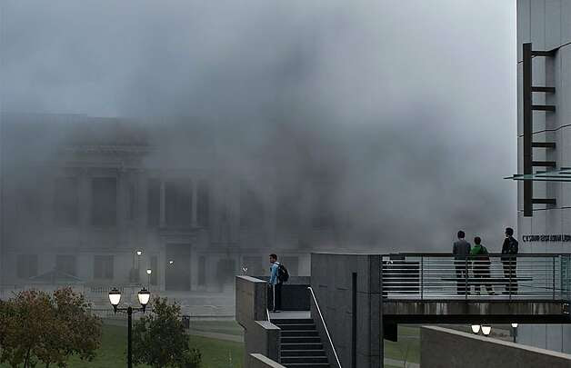 Students watch smoke from the East Asian Library after an explosion on UC Berkeley's campus on September 30, 2013 in Berkeley, Calif. Photo: Michael Drummond, The Daily Californian