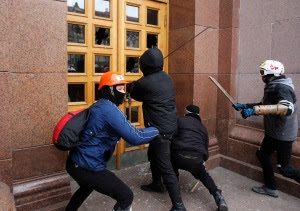 Unidentified men break the door of the Kiev City State Administration (Kiev City Council) building during a rally held by supporters of EU integration in Kiev