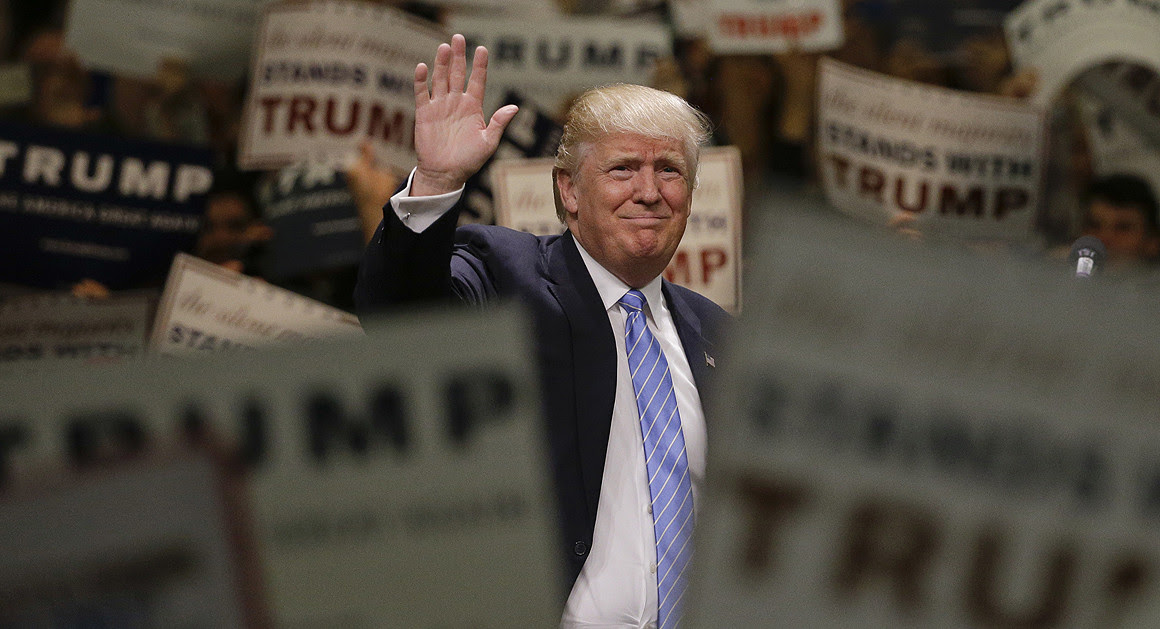 A picture of Trump waving in a crowd, surrounded by supporters