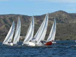 J/24s sailing past mark- Lago San Roque, Argentina