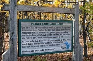 An inscription is shown on a sign near the DNR field office in Crystal Falls.