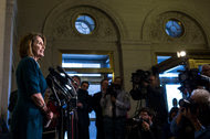 Representative Nancy Pelosi of California was re-elected House Democratic leader on Wednesday.