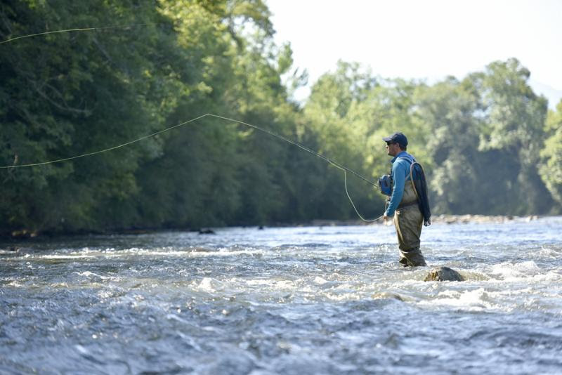 Flyfisherman fishing in mountain river