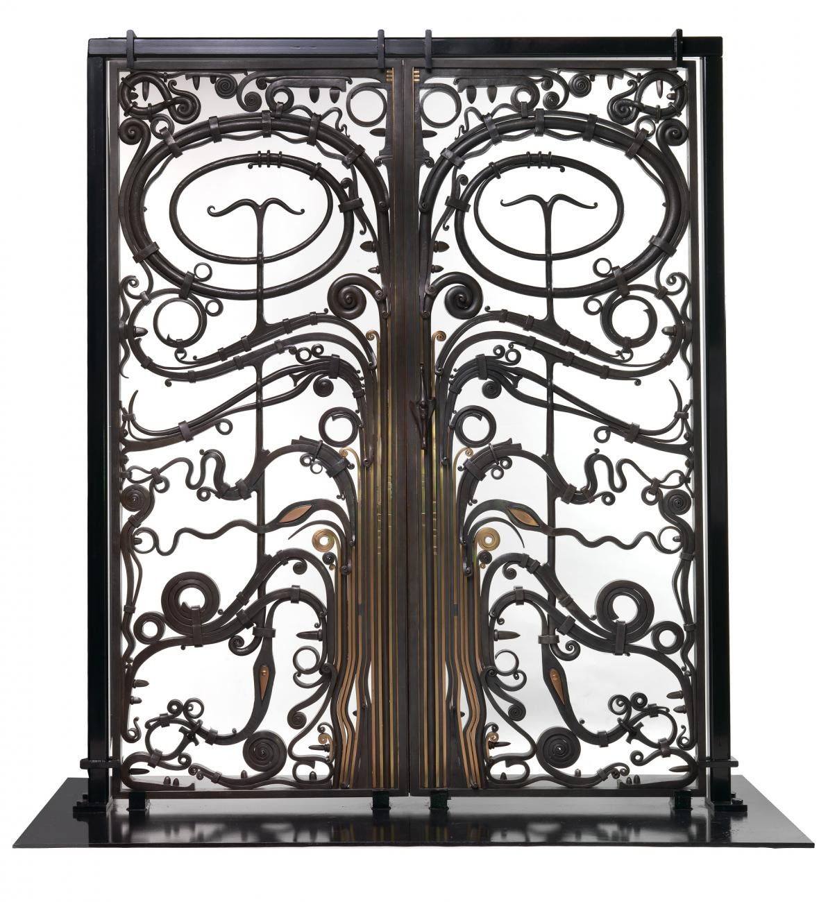 Tall metal gates with swirls and spirals