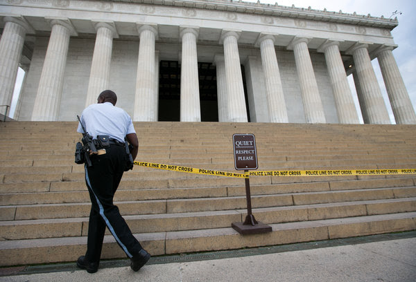 A National Park Service worker at the closed Lincoln Memorial in Washington during the October 2013 government shutdown.
