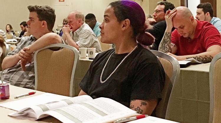 Jessica Pontenot listens to a medical marijuana presentation by U.S. Cannabis Pharmaceutical Research and Development.